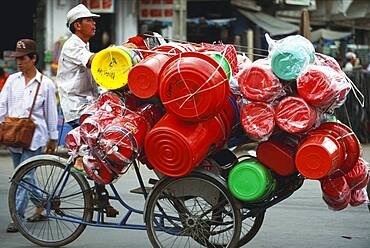 Trader with goods on a bicycle, Chinatown, Saigon, Vietnam, Asia
