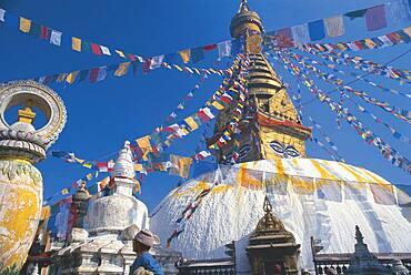 Prayer flags at stupa of Swayambunath under blue sky, Kathmandu, Nepal, Asia