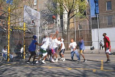Young men playing basketball, Manhattan, New York City, New York, USA, America