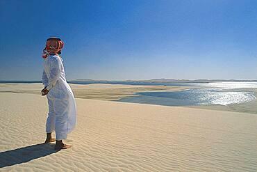 Man with headscarf in the desert, Qatar, Asia