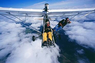 Two parachutists in ultralight airplane