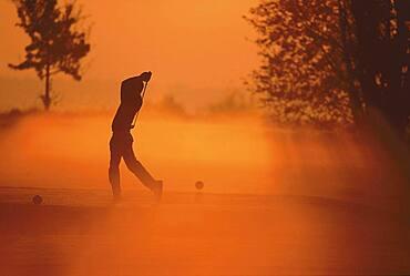 Male Golfer in morning mood