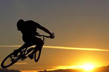 Man jumping on mountain bike