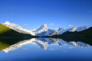 Wetterhorn, Schreckhorn, Finsteraarhorn and Fiescherhorn are reflected in mountain lake, Bachalpsee, Grindelwald, Bernese Oberland, UNESCO World Natural Heritage Swiss Alps Jungfrau-Aletsch, Bernese Alps, Bern, Switzerland
