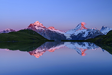 Wetterhorn, Schreckhorn and Finsteraarhorn in alpenglow are reflected in mountain lake, Bachalpsee, Grindelwald, Bernese Oberland, UNESCO World Natural Heritage Swiss Alps Jungfrau-Aletsch, Bernese Alps, Bern, Switzerland