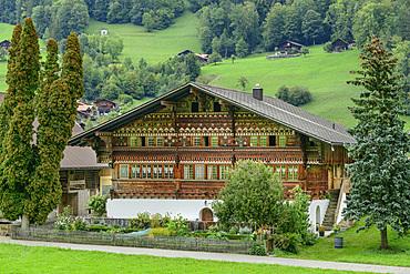 Old farmhouse with carvings, painting and cottage garden, Knuttihaus, Därstetten, Simmental, Bernese Alps, Bern, Switzerland