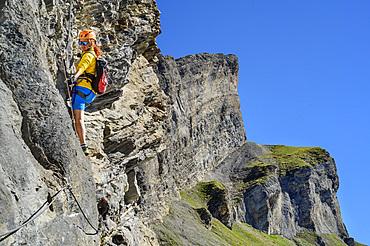 Woman climbs on the Gemmi adventure via ferrata, Gemmi, Bernese Alps, Valais, Switzerland