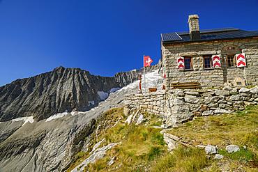 Hut Baltschiederklause with Swiss flag, Baltschiederklause, Bernese Alps, Valais, Switzerland