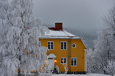 Large, yellow Swedish house in deep winter, Dorotea, Västerbottens Län, Sweden