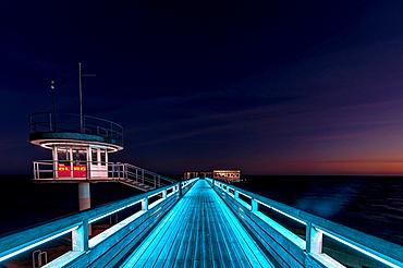 Light illumination of the pier in Kellenhusen at the blue hour, Baltic Sea, Ostholstein, Schleswig-Holstein, Germany