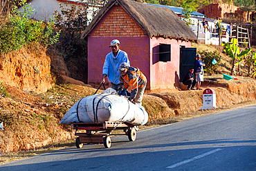 Malagasy people with cart, Madagascar, Africa