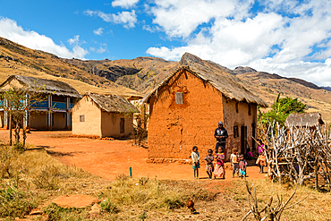 Malagasy children in front of typical house, Tsaranoro Valley, highlands, southern Madagascar, Africa
