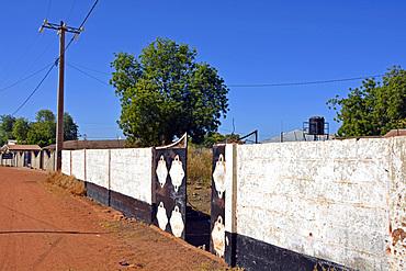Gambia; Central River Region; Kuntaur; on the main street; Wall with entrance gate to a private property