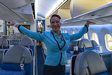 Flight attendant in the Poerava Business Class of Air Tahiti Nui Boeing 787 Dreamliner aircraft at Paris Charles de Gaulle Airport, near Paris, France