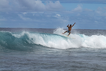 Surfer on breaking wave in Teahupoo surfing area, Tahiti Iti, Tahiti, Windward Islands, French Polynesia, South Pacific