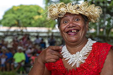 Cheerful Tahitian woman smiles with missing teeth at a cultural festival, Papeete, Tahiti, Windward Islands, French Polynesia, South Pacific