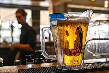 Mug of Hinano beer on counter of a bar, Papeete, Tahiti, Windward Islands, French Polynesia, South Pacific