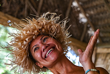 Happy Tahitian woman during an immersion workshop in the ELK cultural village, Apootaata, Moorea, Windward Islands, French Polynesia, South Pacific