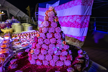 Cake for dessert at the Polynesian evening with a rich buffet and cultural entertainment on board the passenger cargo ship Aranui 5 (Aranui Cruises), at sea near the Marquesas Islands, French Polynesia, South Pacific