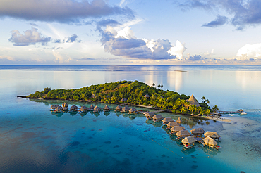Aerial view of Sofitel Bora Bora Private Island Resort with overwater bungalows in Bora Bora lagoon at sunrise, Vaitape, Bora Bora, Leeward Islands, French Polynesia, South Pacific