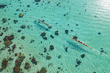 Aerial view of two outrigger racing canoes in the Moorea Lagoon, Avamotu, Moorea, Windward Islands, French Polynesia, South Pacific