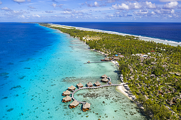 Aerial view of overwater bungalows at Hotel Kia Ora Resort
