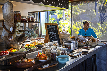 Smiling waitress behind a fantastic breakfast buffet in the Tovolea Restaurant of the Six Senses Fiji Resort, Malolo Island, Mamanuca Group, Fiji Islands, South Pacific