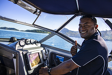 Thumbs up from the boat driver during the speedboat transfer between Six Senses Fiji Resort and Vomo Island Fiji Resort, near Malolo Island, Mamanuca Group, Fiji Islands, South Pacific