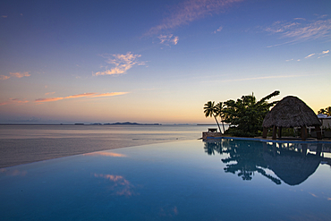 Infinity pool at the Fiji Marriott Resort Momi Bay with a view of the Mamanuca archipelago, Coral Coast, Viti Levu, Fiji Islands, South Pacific