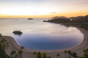 Aerial view of the beach and crescent shaped bay at Six Senses Fiji Resort at sunset, Malolo Island, Mamanuca Group, Fiji Islands, South Pacific