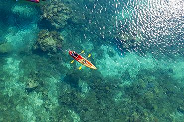 Aerial view of passengers of the cruise ship MV Reef Endeavor (Captain Cook Cruises Fiji) enjoying water sports along a coral reef, Yaqeta, Yangetta Island, Yasawa Group, Fiji Islands, South Pacific
