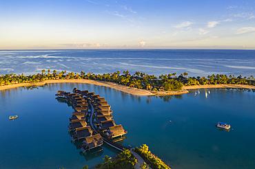 Aerial view of overwater bungalows at Fiji Marriott Resort Momi Bay at sunrise, Momi Bay, Coral Coast, Viti Levu, Fiji Islands, South Pacific