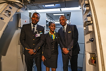 Crew members greet passengers on board a RwandAir Airbus A330-300 airplane for flight from Brussels Airport (BRU) in Belgium to Kigali International Airport (KIG) in Rwanda, Brussels, Belgium, Europe