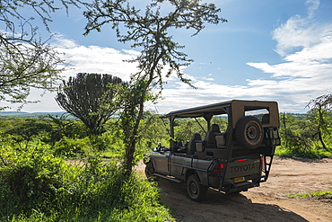 Safari vehicle operated by luxury resort tented Magashi Camp (Wilderness Safaris), Akagera National Park, Eastern Province, Rwanda, Africa