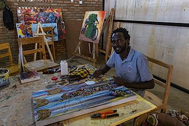 Man paints a picture in an art studio, Kayonza, Eastern Province, Rwanda, Africa