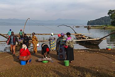 Women with baskets of sambaza fish caught by singing fishermen at Lake Kivu, Cyangugu, Kamembe, Western Province, Rwanda, Africa
