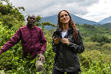 Ranger guide and young woman during a trekking excursion to the Sabyinyo group of gorillas, Volcanoes National Park, Northern Province, Rwanda, Africa