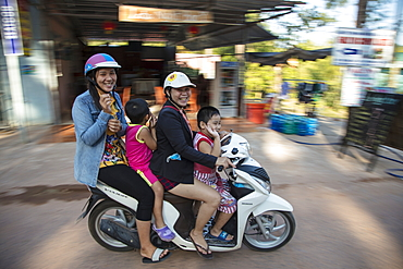 Family affair with two women and two children riding a moped together, Ong Lang, Phu Quoc Island, Kien Giang, Vietnam, Asia