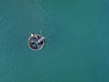 Aerial view of fisherman in traditional round boat in turquoise water, Ong Lang, Phu Quoc Island, Kien Giang, Vietnam, Asia