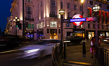 Evening shot of traffic and the classic London Underground sign. Shot in Piccadilly Circus in London, UK.