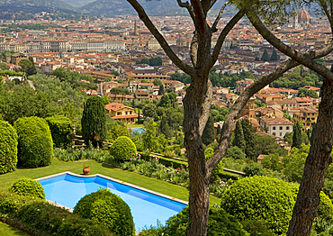 View of Firenze froma garden with a pool, overlooking the city.