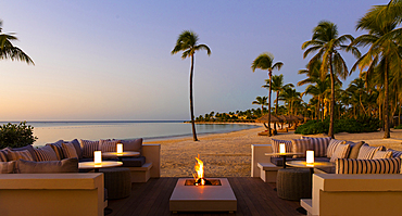 A firepit set on a Caribbean beach. Shot in the fading light of day on an island near Antigua.