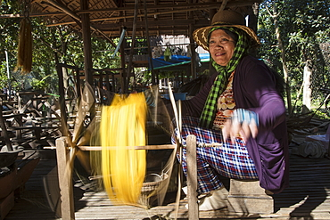 Woman weaves silk on loom in a silk factory, Oknha Tey Island, Mekong River, near Phnom Penh, Cambodia, Asia