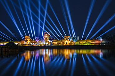 Spectacular light show at the illuminated Angkor Wat temple with reflection in the moat at night, Angkor Wat, near Siem Reap, Siem Reap Province, Cambodia, Asia