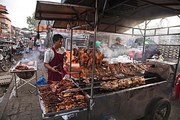 Grilled chicken at a street food stall outside the Phsar Kandal Market, Phnom Penh, Cambodia, Asia