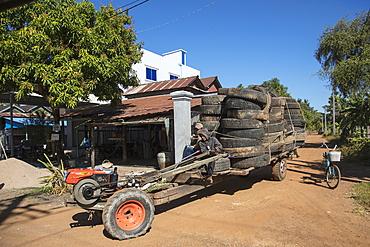 Tires are transported with a massive vehicle, near Kampong Chhnang, Kampong Chhnang, Cambodia, Asia