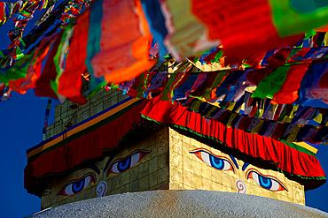 Buddha's eyes at the stupa of Bodnath, Kathmandu, Nepal, Asia.