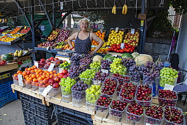 Woman sells cherries and other fruits at a market stall, Pula, Istria, Croatia, Europe