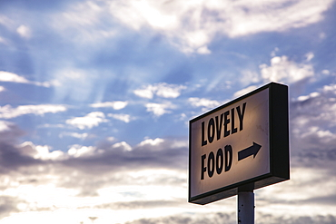 """Illuminated sign reading """"Lovely Food"""" in front of a restaurant, Vis, Vis, Split-Dalmatia, Croatia, Europe"""