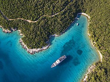 Aerial view of cruise ship in pristine bay at a swim stop for passengers, near Kampor, Primorje-Gorski Kotar, Croatia, Europe